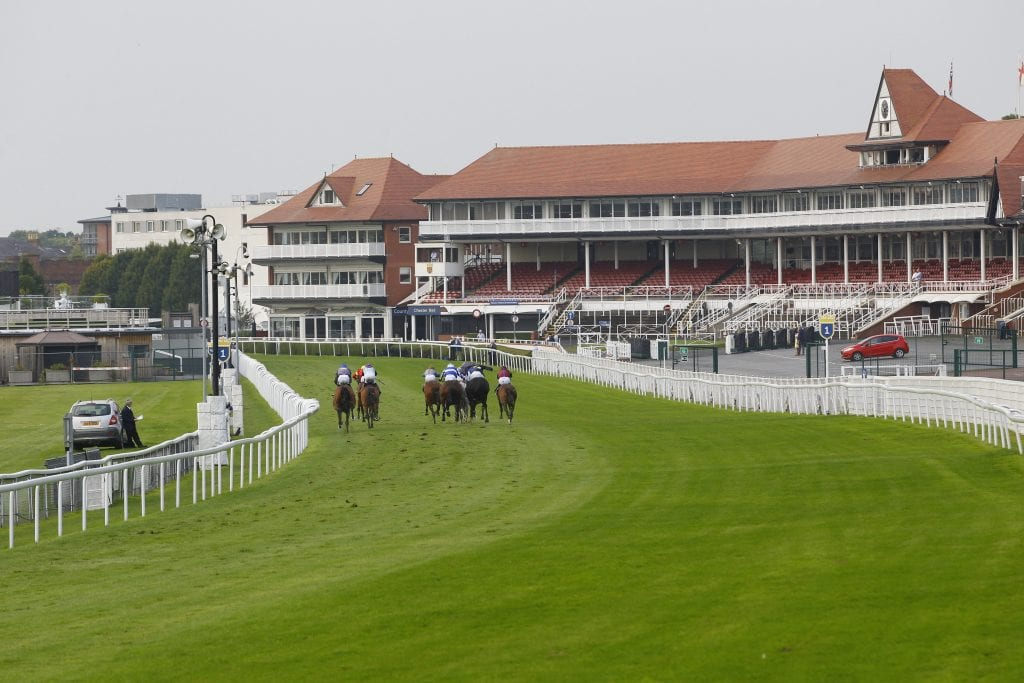 Horses Heading Into The Home Straight At Chester Racecourse During The First Behind Closed Doors Fixture