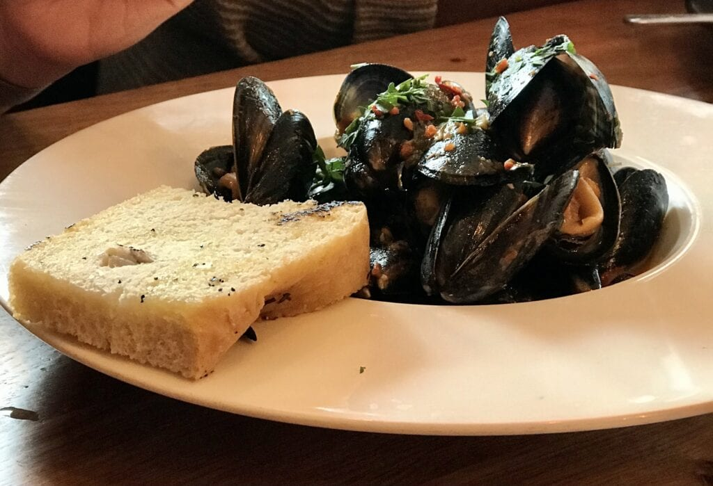 the yard mussels gently cooked in spicy tomato sauce with herbs